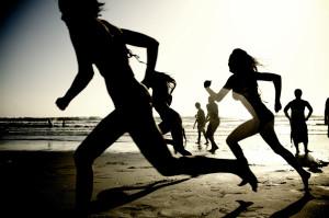 Girls running on the beach (#62902)