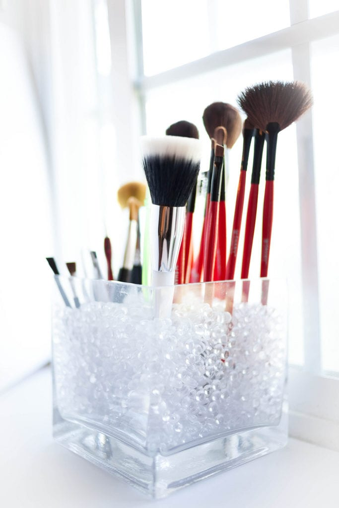 Multiple makeup brushes.