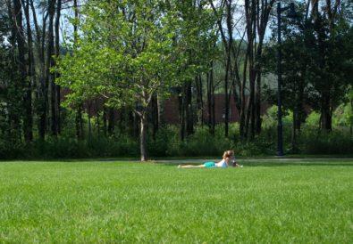 Girl reading outside.