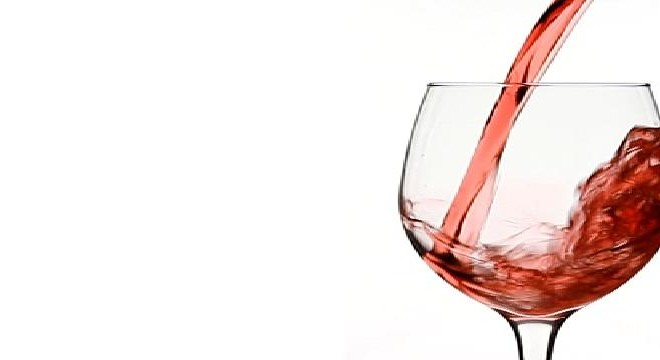 Pouring Red Wine in to Wine Glass