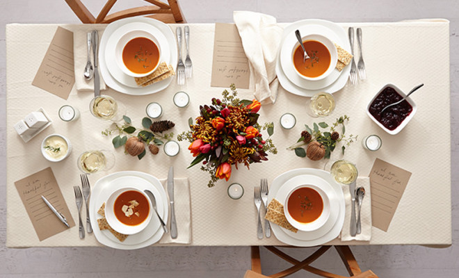 Millennial minimalist table setting for Thanskgiving with floral centerpiece