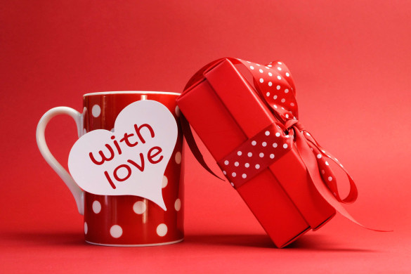Holidays___Saint_Valentines_Day_Cup_with_a_gift_on_Valentine_s_Day_February_14_061403_
