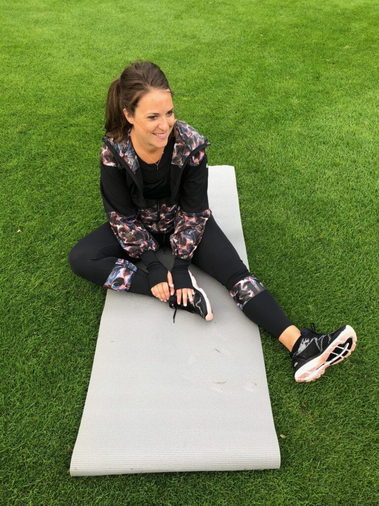 Sarah outside on a yoga mat