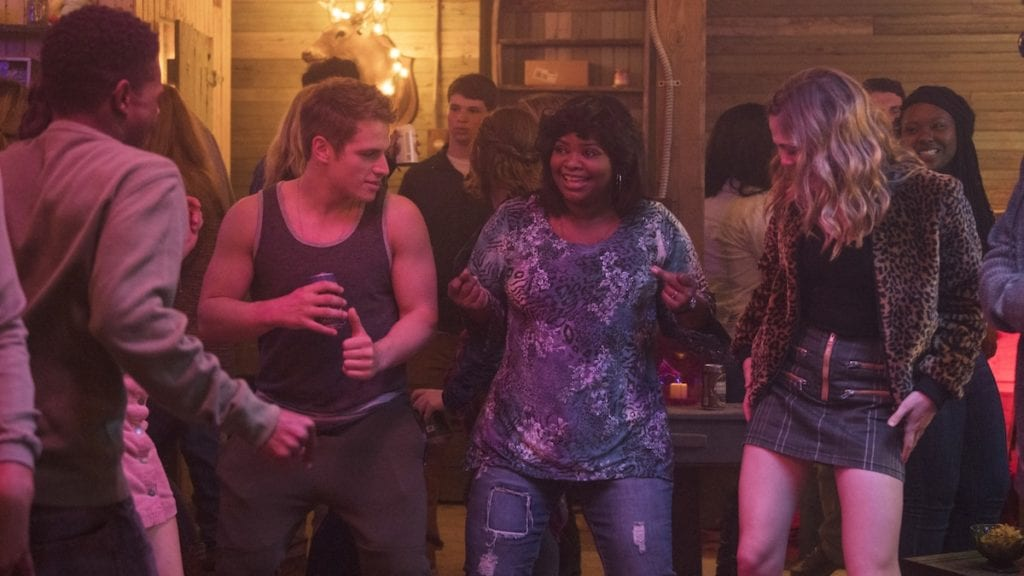 Ma (Octavia Spencer) dancing with high schoolers in her basement