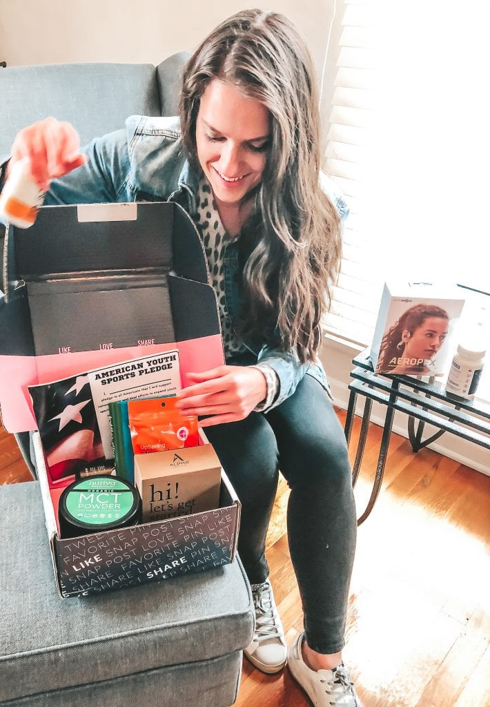 Sarah behind box of products for inspiring you to keep your New Years resolutions