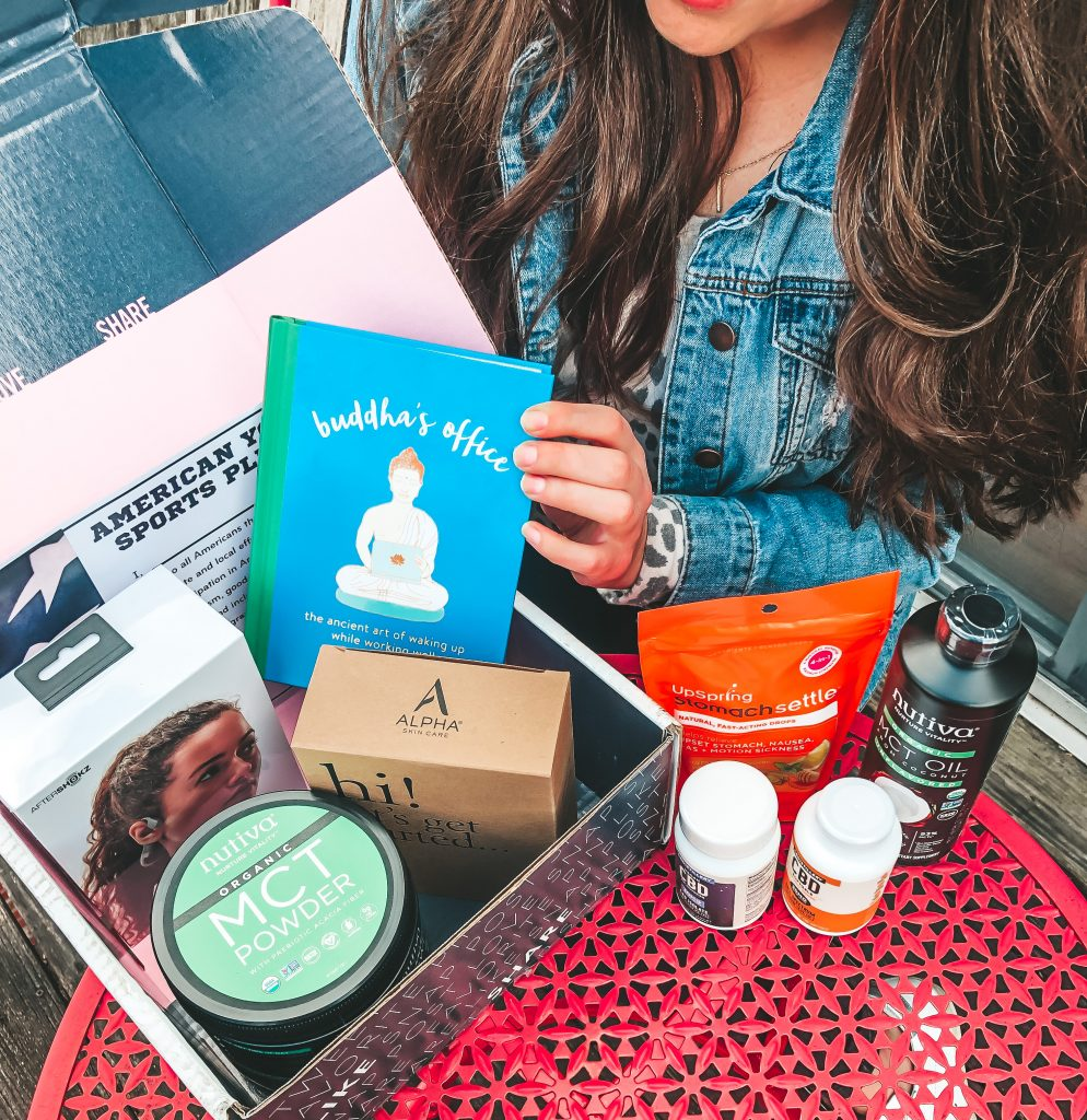 Sarah with a box of products to inspire you to keep your New Years resolutions