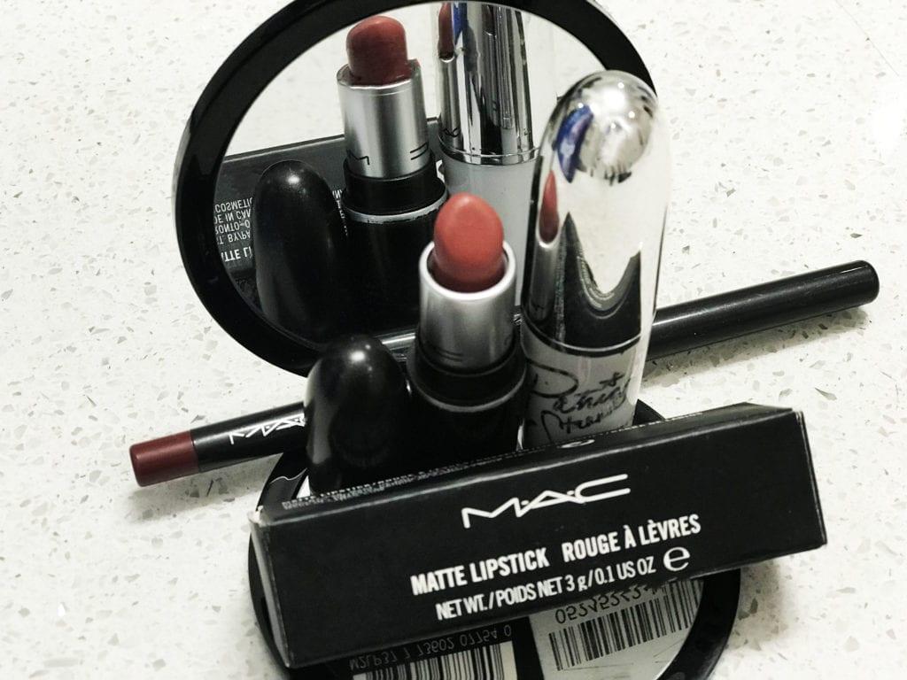 "Alt=Mac Cosmetics lipsticks and lipliner in mirror reflection"""