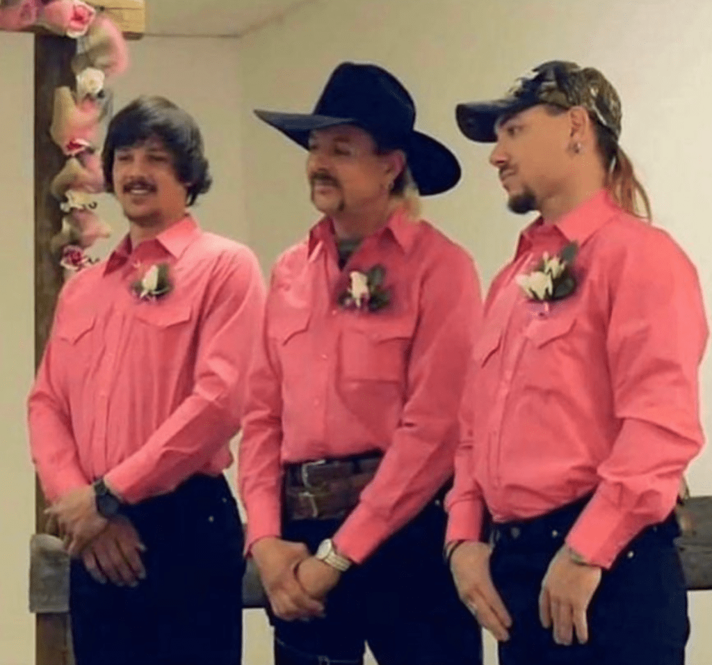 Travis, Joe, and John at their wedding dressed in matching pink shirts