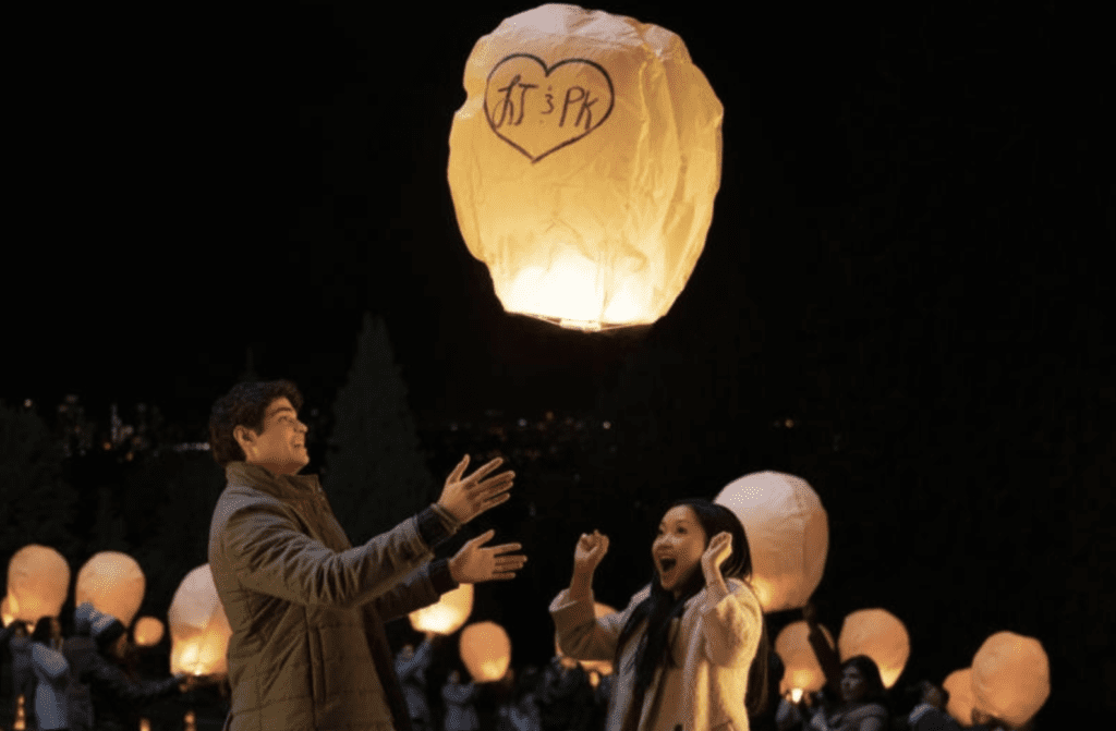 Boy and girl releasing paper lantern in Netflix Original rom-com To All The Boys
