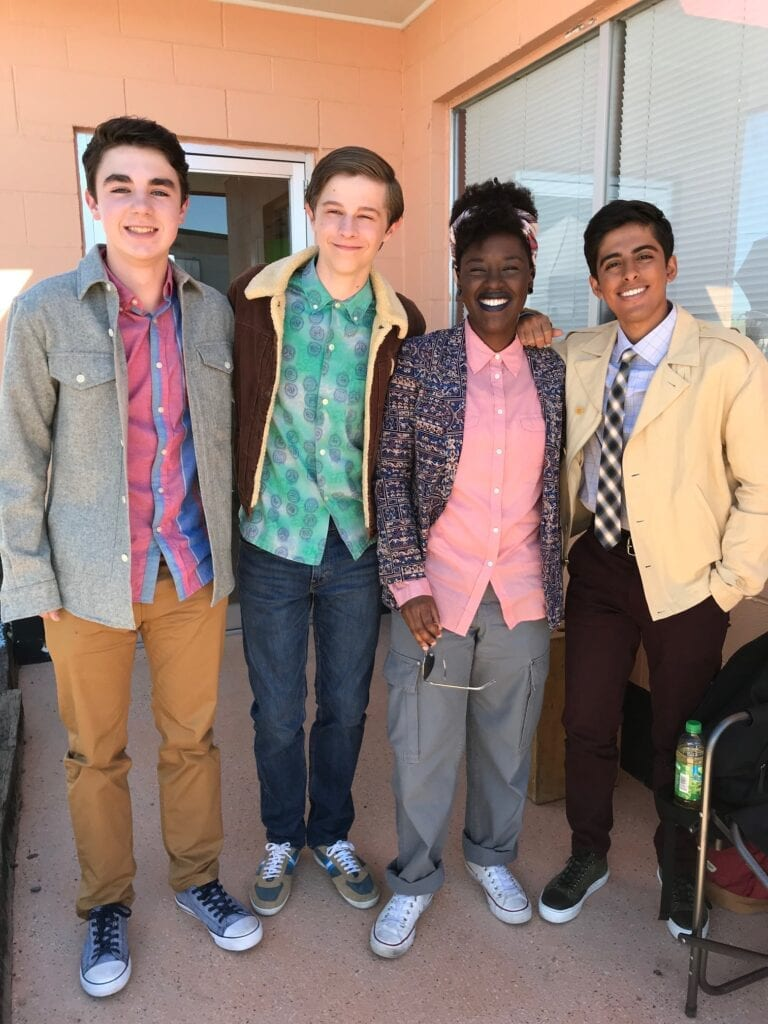 Collin Blackford with three friends