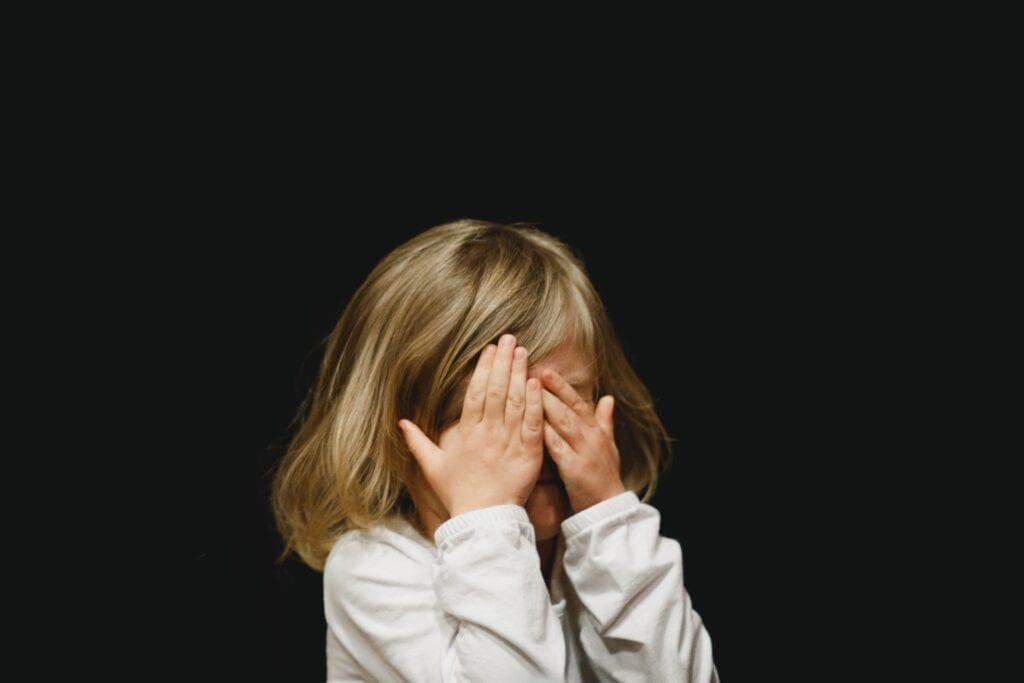 Child covering eyes