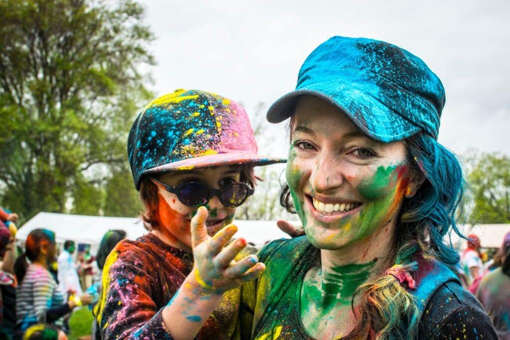 Mother and son covered in colorful powder