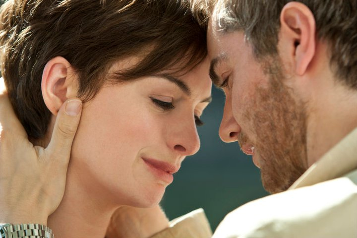 "Jim Sturges holds Anne Hathaway in ""One Day"" movie"