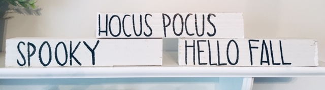 small white blocks with various words written on them: hocus pocus, spooky, hello fall