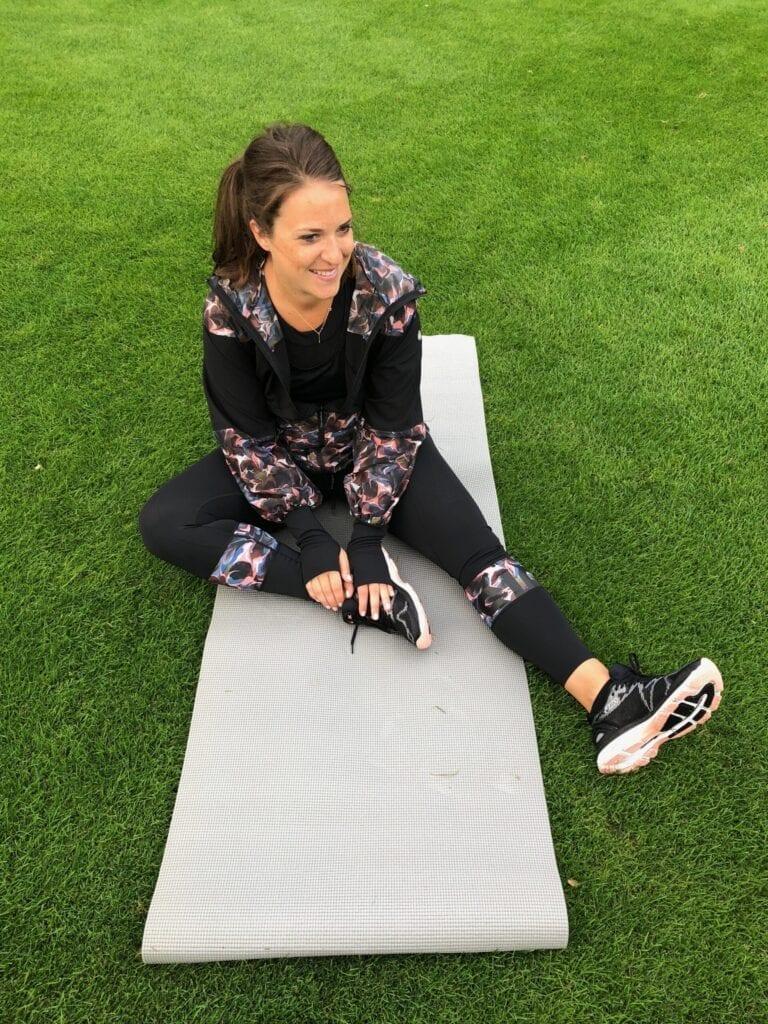 Sarah outside on a yoga mat