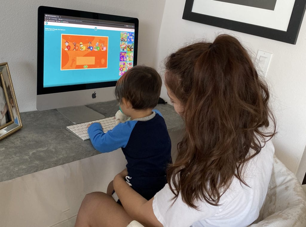 "Alt= "" Mother and son on website with free educational activities"""