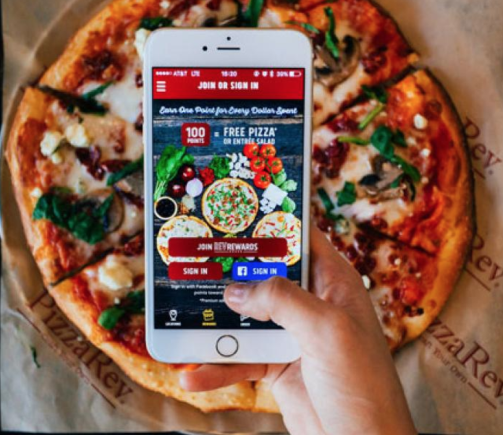 Fast food App opened with a pizza in the background.