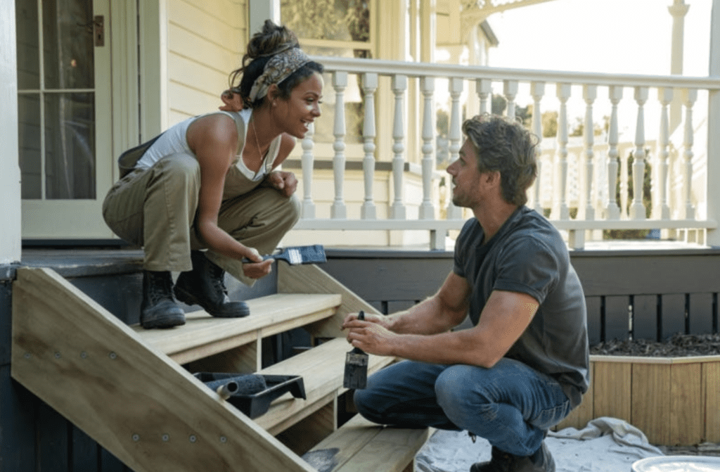 Boy and girl fixing porch stairs in Falling Inn Love