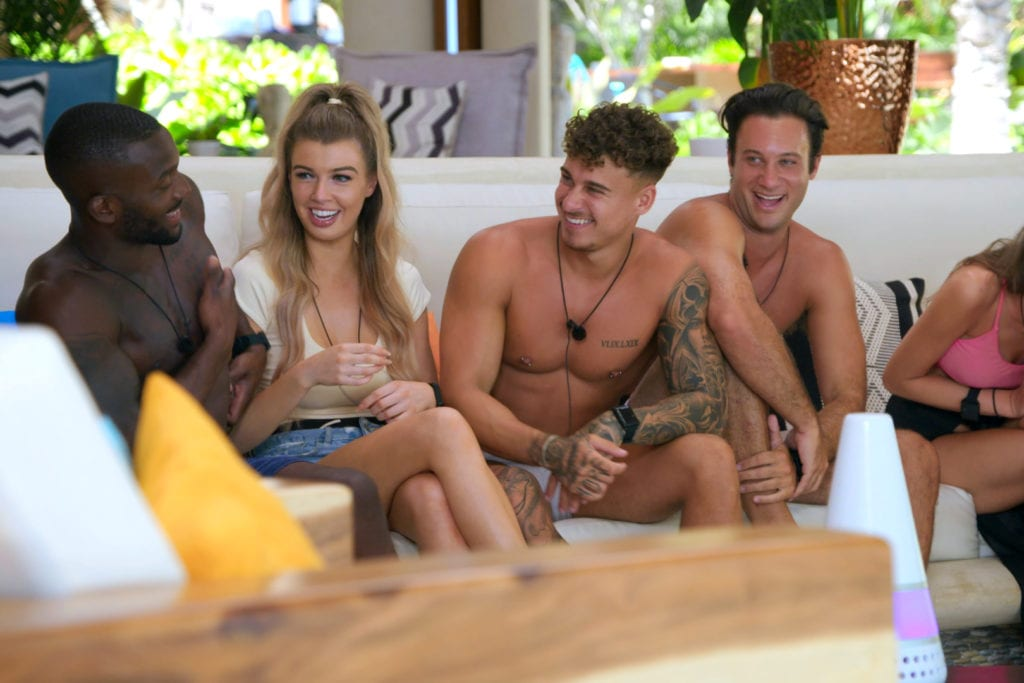 Kori sits with other contestants on Too Hot to Handle