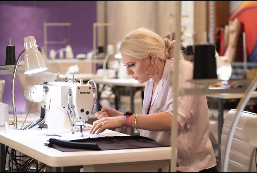 Brittany Allen at a sewing table on Project Runway