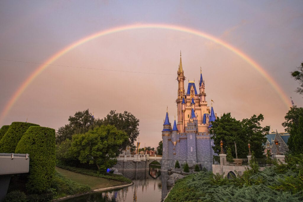 photo of Cinderella's castle at Walt Disney World with a rainbow over top