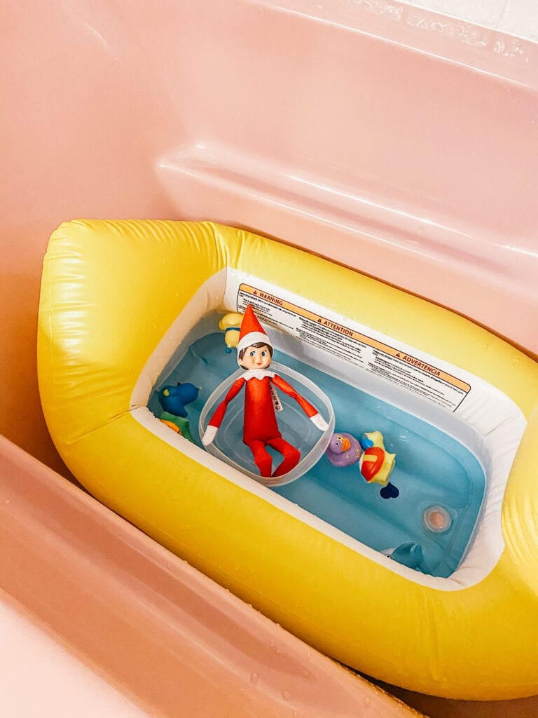 Elf in the tub with bath toys