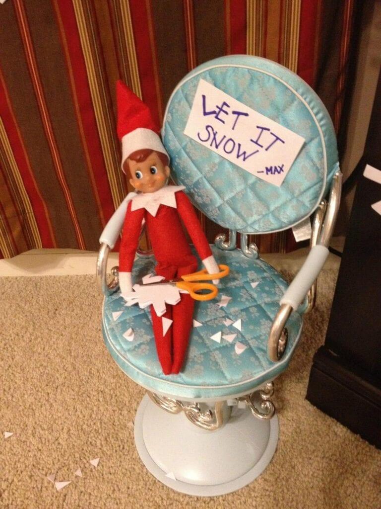Elf in chair making snowflakes