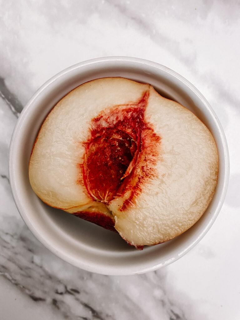 simple baked peaches recipe cut open fresh peach